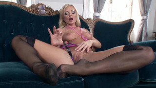 Silvia Saint in black stockings teasing and showing her pussy