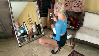 Janice Griffith doing selfie in front of the mirror