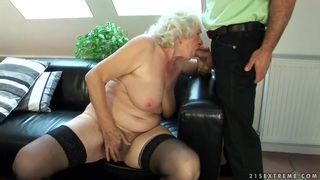 Sweet old chick Norma is fucking with a younger boy