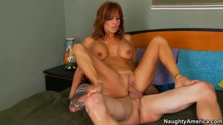 Pauly Harker gets a titjob and lusty cock sucking from Tara Holiday