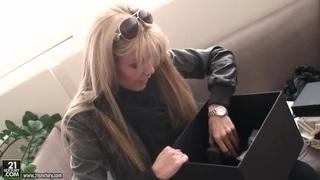 Blonde pornstar Sophie Moone opens her present