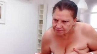 OmaFotze Mature doing striptease and masturbating