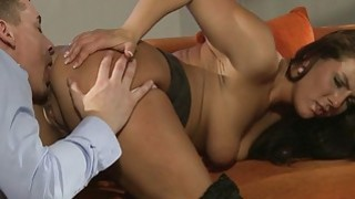 Tanned beautiful mom bangs on the sofa