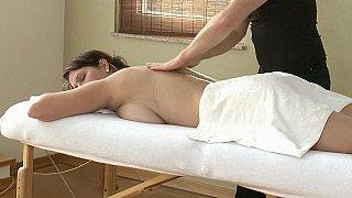 Massaging her massive natural boobs