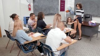 Adriana Chechik and Kimmy Granger suck dildo in the classroom