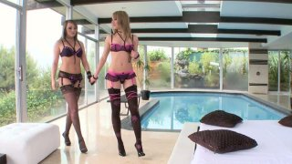 Lesbian friends Blue Angel and Charlie Laine make out by the indoor pool